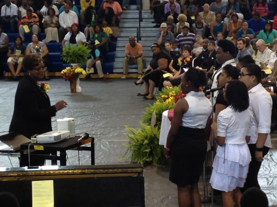 the choir performing at 8th grade graduation