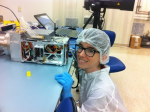 "Sarah with a thermal infrared remote sensing spectrometer built by my research group at the University of Hawaii.  ""We were testing it prior to installing it in a University of Hawaii-built small satellite, which attempted to launch into space in November of 2015 (sadly, the launch failed).  It would have measured volcanic gases from space."""