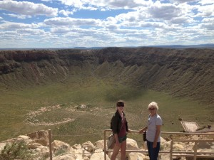 "Sarah and her mom at Barringer Meteor Crater in Arizona.  ""This is an extremely well-preserved impact crater on Earth that was used as a training location for the Apollo astronauts!  I attended a field camp there as a graduate student, and was visiting just as a tourist to show it to my mom on this occasion."""