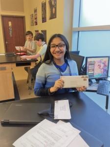 Smiling girl holding envelope